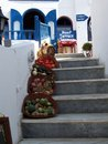 Santorini streets and sidewalks fruits vegetables on stairway entice travelers to come in dine Royalty Free Stock Images