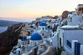 Santorini sunset greece over buildings and churches Stock Image