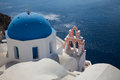 Santorini white church of with the mountains and sea in the background Stock Photography