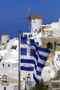 Santorini with windmill in Oia, Greece Royalty Free Stock Photos