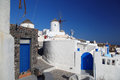 Santorini with windmill in oia greece amazing old against blue sky village Royalty Free Stock Images