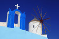 Santorini with windmill in oia greece amazing old against cross village Stock Images