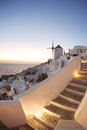 Santorini with windmill in oia greece amazing old against sunset village Royalty Free Stock Image
