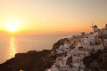 Santorini with windmill in oia greece amazing old against sunset village Stock Image
