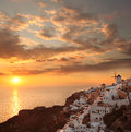 Santorini with windmill in oia greece amazing old against sunset village Royalty Free Stock Photography