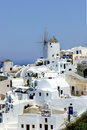 Santorini windmills small white houses and streets Royalty Free Stock Photography