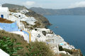 Santorinian landscape with terrace buildings and blue sea Royalty Free Stock Photos