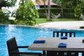 Sanya: poolside dining table Royalty Free Stock Photo