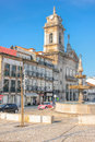 Sao pedro church guimaraes portugal typical architecture and fountain in toural square Stock Photography