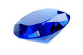 Sapphire blue gemstone on a white background Royalty Free Stock Photo