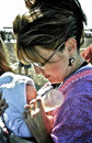 Sarah palin feeding her baby trig governor bottle new at the whale festival in barrow alaska in she is wearing a native kuspuk and Stock Image