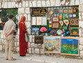 Sarajevo bosnia and herzegovina aug muslim couple in front of the street stand with souvenirs on august in b h bascarsija Royalty Free Stock Photos