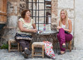 Sarajevo women bosnia and herzegovina august two sit and drink in front of the house on bascarsija the old town very popular Stock Images