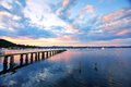 Saratoga sunset jetty wharf and yachts moored at on the central coast australia Stock Photo