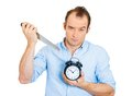 Sarcastic man holding knife and clock Stock Image