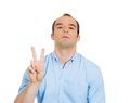Sarcastic man, victory sign Royalty Free Stock Photos