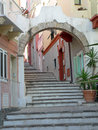 Sardinia island of san pietro carloforte charateristic corner town arch on stairway Royalty Free Stock Photo