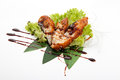 Sashimi fried perch of idzumi tai kabayaki on banana leaves on a white background Stock Images