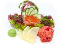 Sashimi japanese cuisine with vegetables and fish in a restaurant Stock Photo