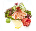 Sashimi japanese cuisine with vegetables and fish in a restaurant Stock Image