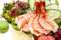 Sashimi japanese cuisine with vegetables and fish in a restaurant Stock Images