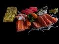 Sashimi Japanese food on black background. Raw fish fillets sal