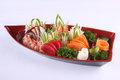 Sashimi set on white background japanese delicacy cons consisting of very fresh raw meat or seafood sliced into thin pieces Royalty Free Stock Images