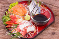 Sashimi sets on wooden table Stock Images
