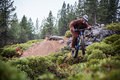 Sasquatch yeti jumps a bicycle in the air his bicyclke over dirt jump near deschutes national forest bend oregon Royalty Free Stock Photo