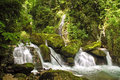 Sassenage waterfall natural waterfalls in the forested hills above france Stock Photography