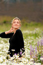Sassy blond in a field of daisy's. Stock Photos