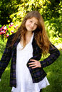 Sassy preteen girl pretty smiling country with hand on hip shallow depth of field Royalty Free Stock Photo