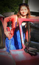 Sassy tween with old car a pretty girl happy to have a even if it is concept Royalty Free Stock Photos