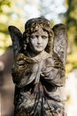 A sat old angel monument of on graveyard Royalty Free Stock Photography