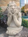 Satan devil statue sculpture of the or the mocking putting his tongue out Stock Image