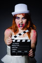 Satan halloween concept with movie clapper board Stock Photos