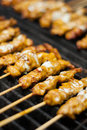 Satay chicken on grill. Stock Photo