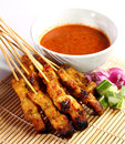Satay malaysian chicken with delicious peanut sauce one of famous local dishes Stock Images