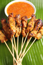 Satay malaysian chicken with delicious peanut sauce one of famous local dishes Stock Photos
