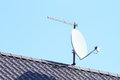 Satelite with antena white and internet connection on grey roof Royalty Free Stock Image