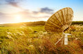 Satellite antenna in the wilderness sunset in grassland and reeds Stock Photo