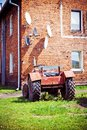 Satellite antennas and tractor, alternative life Royalty Free Stock Photo