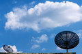 Satellite dish antenna on blue sky with cloud Royalty Free Stock Photo