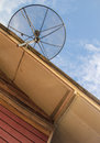 Satellite dish antenna for television on house roof Royalty Free Stock Photo