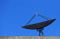 Satellite Dish with Blue Sky on Roof Royalty Free Stock Images