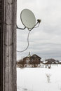 Satellite dish hanging on a wooden house in the village Royalty Free Stock Photo