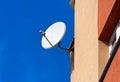 Satellite Dish mounted on  brick wall Royalty Free Stock Image