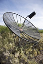 Satellite dish old abandoned in the arizona desert Stock Photo