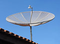 Satellite dish on the roof of a house Royalty Free Stock Images