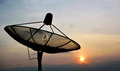 Satellite dish and the sun Royalty Free Stock Photography